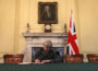 LONDON, ENGLAND - MARCH 28:  British Prime Minister Theresa May in the cabinet, sitting below a painting of Britain's first Prime Minister Robert Walpole, signs the official letter to European Council President Donald Tusk invoking Article 50 and the United Kingdom's intention to leave the EU on March 28, 2017 in London, England. After holding a referendum in June 2016 the United Kingdom voted to leave the European Union, the signing of Article 50 now officially triggers that process.  (Photo by Christopher Furlong - WPA Pool/Getty Images)